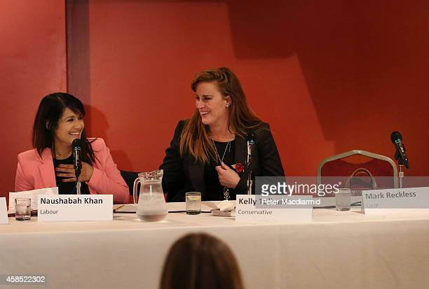 Rochester And Strood byelection candidates Naushabah Khan of the Labour Party and Conservative Kelly Tolhurst sit next to an empty seat reserved for...