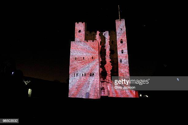 Rochester Castle is illuminated by a 3D animation lightshow on April 16 2010 in Rochester England Images of rock band AC/DC and images from Iron Man...