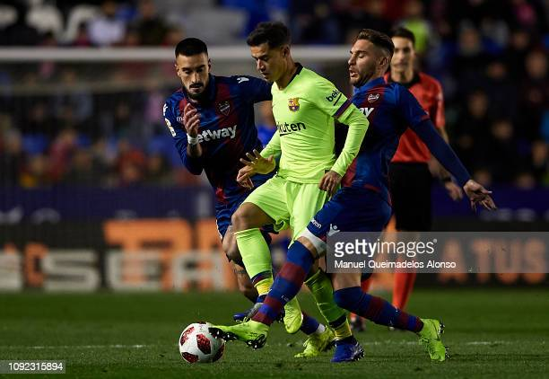 Rochina of Levante UD competes for the ball with Philippe Coutinho of FC Barcelona during the Copa del Rey Round of 16 first leg match between...