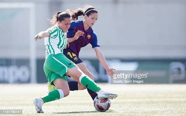 Rocio Galvez of Real Betis competes for the ball with Aitana Bonmati of FC Barcelona during the La Liga Iberdrola first division match between Real...