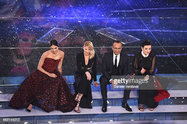 Rocio Munoz Morales Emma Marrone Carlo Conti and Arisa attend the opening night of the 65th Festival di Sanremo 2015 at Teatro Ariston on February 10...