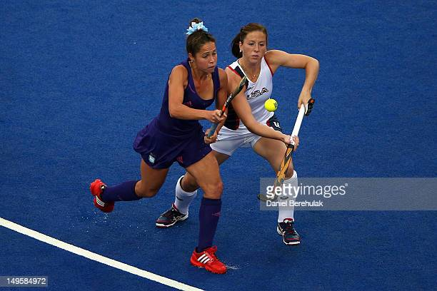 Rocio Sanchez Moccia of Argentina competes for the ball with Julia Reinprecht of the United States during the Women's Hockey Match between Argentina...