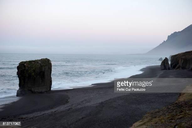 Rock and Dvotta black beach of Alftafjordur, South Iceland