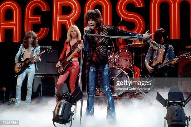 Rock and roll band Aerosmith perform on the Midnight Special TV Show on November 24 1978 in Los Angeles California LR Brad Whitford Tom Hamilton...