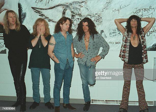 Rock and roll band Aerosmith pose for a portrait backstage in 1993 LR Tom Hamilton Brad Whitford Joey Kramer Joe Perry Steven Tyler