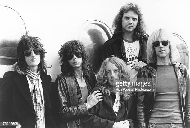Rock and roll band 'Aerosmith' pose for a portrait in fron of their plane in circa 1978 LR Joe Perry Steven Tyler Brad Whitford Joey Kramer Tom...