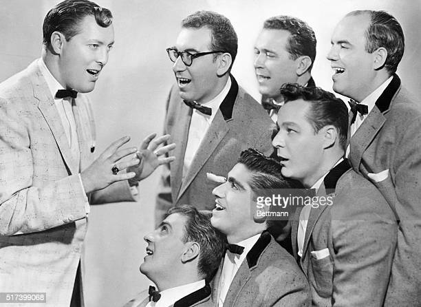 Rock and roll band Bill Haley His Comets sings in matching tuxedos