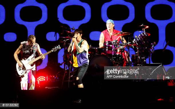 US rock and roll band Red hot Chili Peppers' vocalist Anthony Kiedis drummer Chad Smith and bassist Flea perform on stage during the Benicassim...