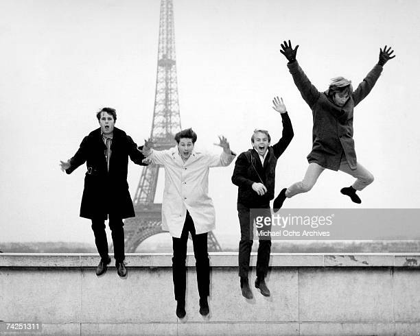 Rock and roll band The Beach Boys jump off a ledge in front of the Eiffel Tower in November 1964 in Paris France
