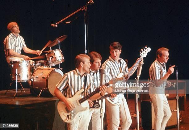 "Rock and roll band ""The Beach Boys"" perform onstage in circa 1964 in California. Dennis Wilson, Al Jardine, Carl Wilson, Brian Wilson, Mike Love."