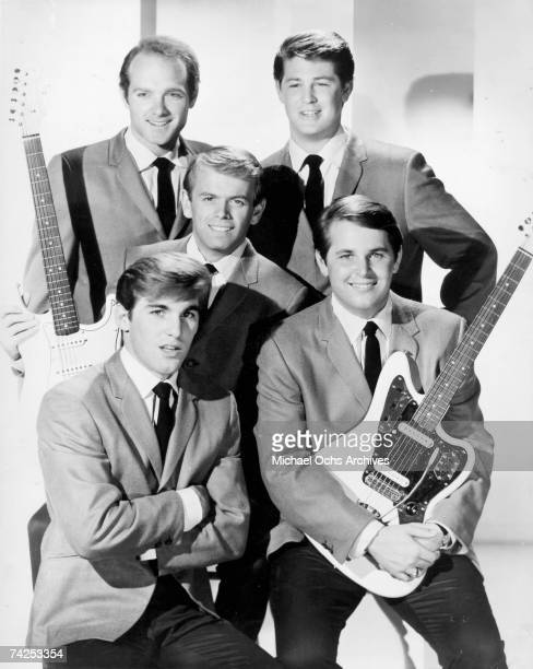 """Rock and roll band """"The Beach Boys"""" pose for a portrait holding Fender electric guitars in 1964. Clockwise from top left: Mike Love, Brian Wilson,..."""