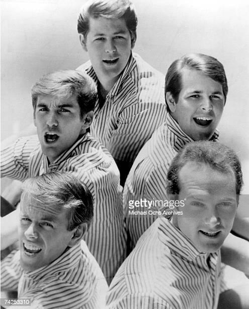 """Rock and roll band """"The Beach Boys"""" pose for a portrait in 1964. Clockwise from bottom left: Al Jardine, Dennis Wilson, Brian Wilson, Carl Wilson,..."""