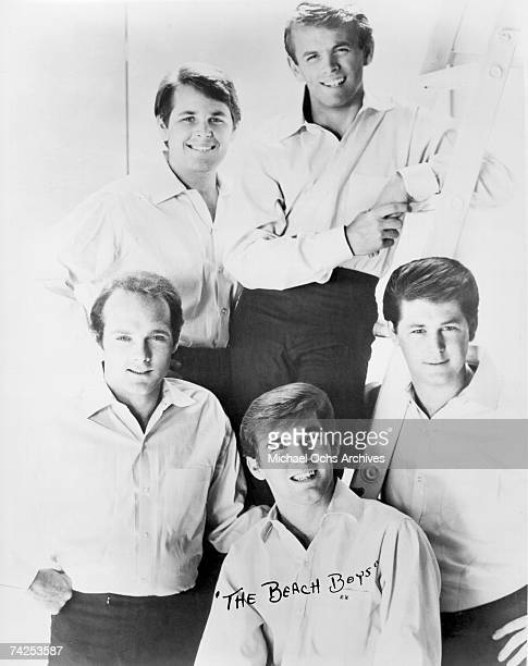 """Rock and roll band """"The Beach Boys"""" pose for a portrait in 1964. Clockwise from bottom left: Mike Love, Carl Wilson, Al Jardine, Brian Wilson, Dennis..."""
