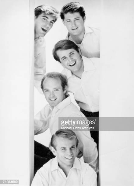 """Rock and roll band """"The Beach Boys"""" pose for a portrait in 1964. Top to bottom: Dennis Wilson, Brian Wilson, Carl Wilson, Mike Love, Al Jardine."""