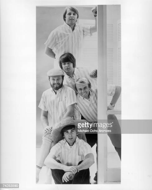 """Rock and roll band """"The Beach Boys"""" pose for a portrait in 1964. Top to bottom: Carl Wilson, Brian Wilson, Mike Love, Al Jardine, Dennis Wilson."""