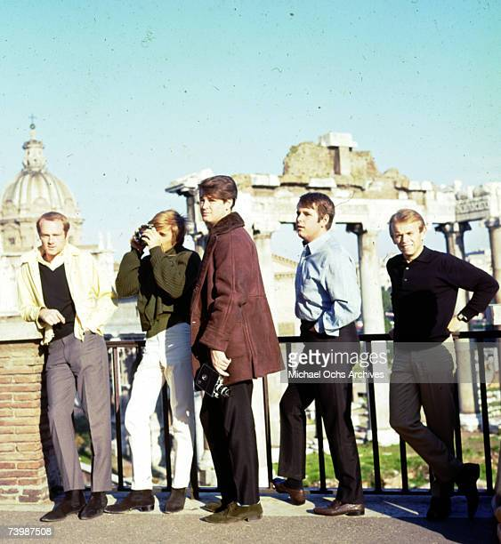 Rock and roll band 'The Beach Boys' pose for a portrait in front of some ruins in Europe in November 1964 Mike Love Dennis Wilson Brian Wilson Carl...