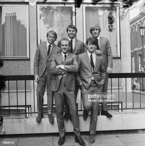 Rock and roll band The Beach Boys pose for a portrait on November 2 1964 in London England LR front row Mike Love Brian Wilson LR back row Al Jardine...