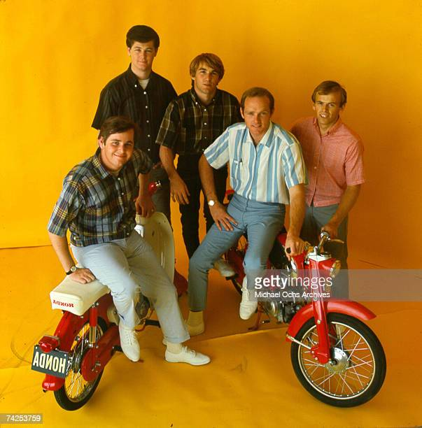 """Rock and roll band """"The Beach Boys"""" pose for a portrait with 2 Honda Mo-peds in circa 1964 in Los Angeles, California. Al Jardine, Mike Love, Dennis..."""