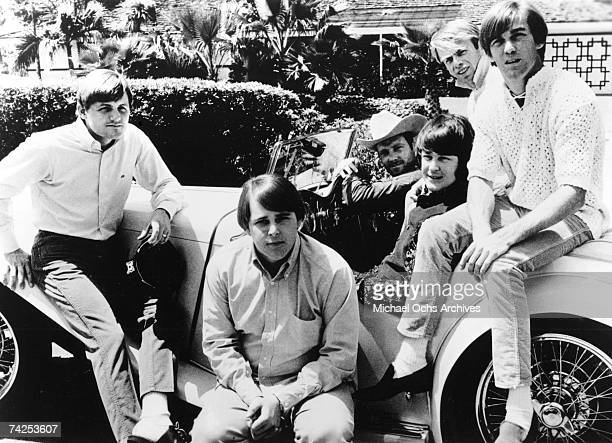 Rock and roll band The Beach Boys pose for a portrait with an antique car in 1966 Bruce Johnston Carl Wilson Mike Love Brian Wilson Al Jardine Dennis...