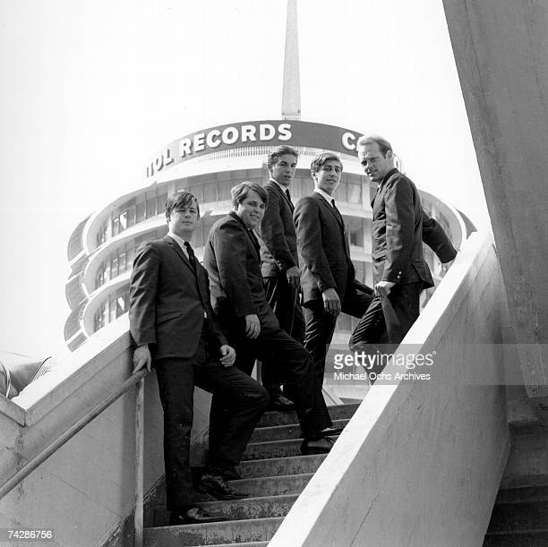 """Rock and roll band """"The Beach Boys"""" pose for a portrait with the Capitol Records building in the background. David Marks replaced Al Jardine from..."""