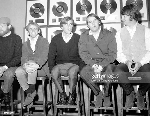 Rock and roll band 'The Beach Boys' poses for a portrait in front of a wall full of their gold records Novermber 1965 Mike Love Al Jardine Dennis...