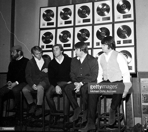 Rock and roll band The Beach Boys poses for a portrait in front of a wall full of their gold records Novermber 1965 Mike Love Al Jardine Dennis...