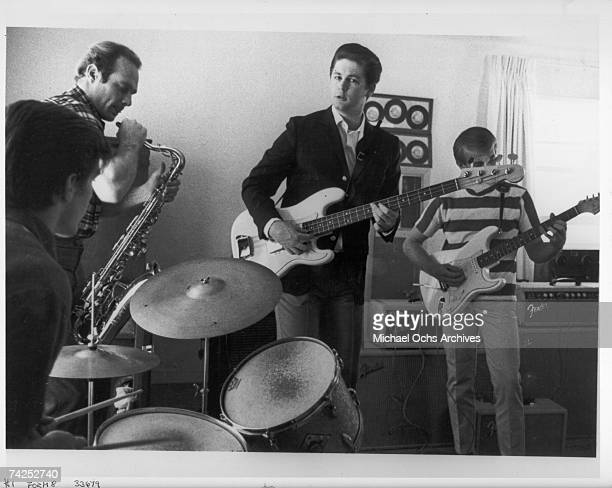 Rock and roll band The Beach Boys rehearse at home in 1964 in Los Angeles California Mike Love Dennis Wilson Brian Wilson Al Jardine Carl Wilson