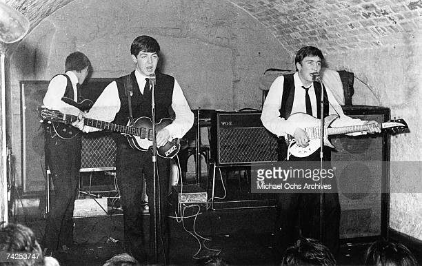 Rock and roll band 'The Beatles' perform onstage at the Cavern Club on August 22 1962 George Harrison Paul McCartney John Lennon