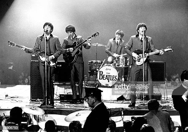 "Rock and roll band ""The Beatles"" perform onstage at the Washington Coliseum on February 11, 1964 in Washington, D.C. Paul McCartney, George Harrison,..."