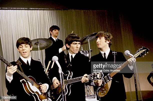 Rock and roll band 'The Beatles' perform onstage in a still from their movie 'A Hard Day's Night' which was released in 1964 Paul McCartney Ringo...