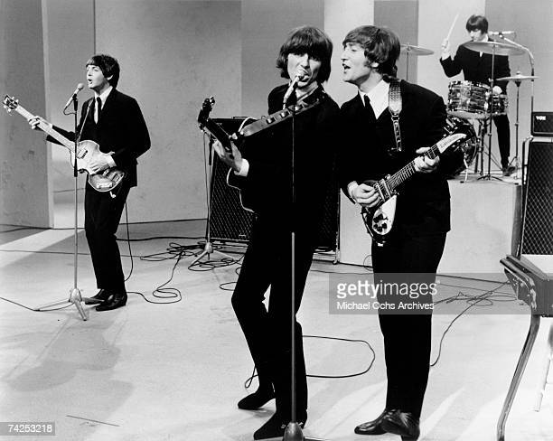 Rock and roll band 'The Beatles' performs on a TV show in 1964 in London England Paul McCartney George Harrison John Lennon Ringo Starr