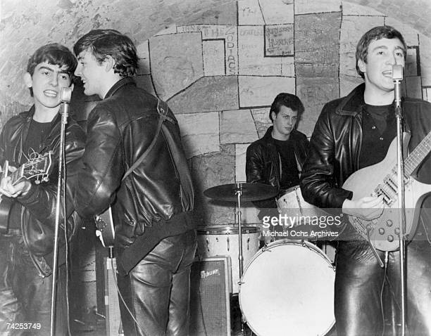 Rock and roll band 'The Beatles' performs onstage at the Cavern Club in February 1961 in Liverpool England George Harrison Paul McCartney Pete Best...