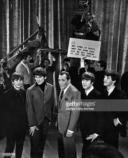 Rock and roll band The Beatles talk to Ed Sullivan as they prepare for their performance on The Ed Sullivan Show on February 16 1964 in Miami Florida...