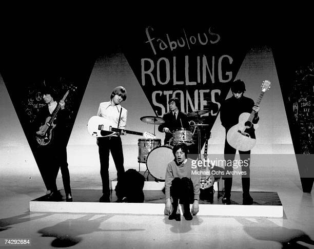 Rock and roll band 'The Rolling Stones' Bill Wyman Brian Jones Charlie Watts Mick Jagger and Keith Richards rehearse for an appearance on a British...