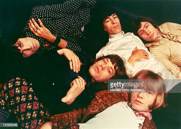 Rock and roll band The Rolling Stones pose for a portrait lying down Keith Richards Bill Wyman Charlie Watts Brian Jones Mick Jagger