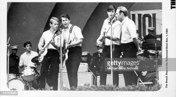 Rock and roll group The Beach Boys perform onstage at the Hollywood Bowl on October 19 1963 in Los Angeles California Dennis Wilson Al Jardine Carl...