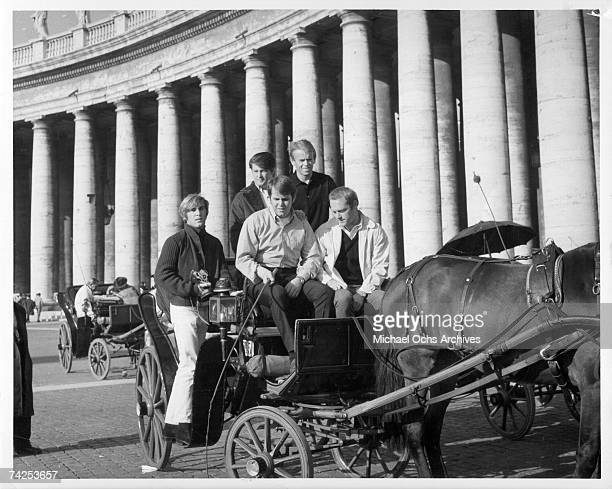 Rock and roll group The Beach Boys pose for a portrait riding in the back of a horse drawn carriage in November 12 1964 in Italy Dennis Wilson Brian...