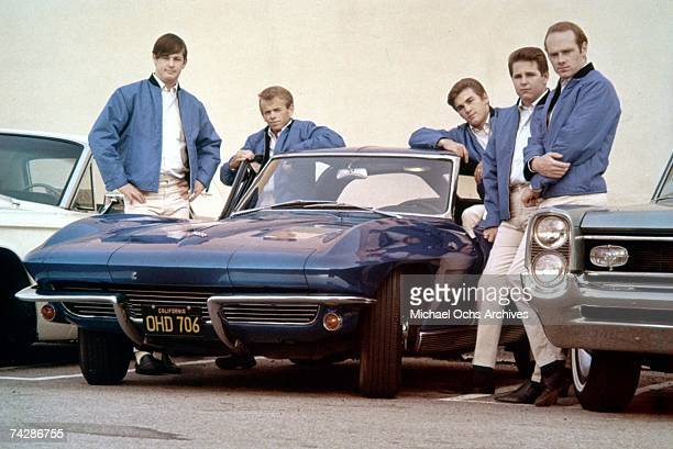 Rock and roll group The Beach Boys pose with Corvette in their first photo session since Al Jardine returned to the band in Novermber 1963 Brian...