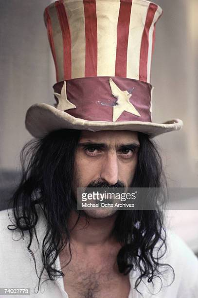 Rock and roll guitar player Frank Zappa poses for a portrait wearing an Uncle Sam stars stripes top hat in March 1979 in Los Angeles California