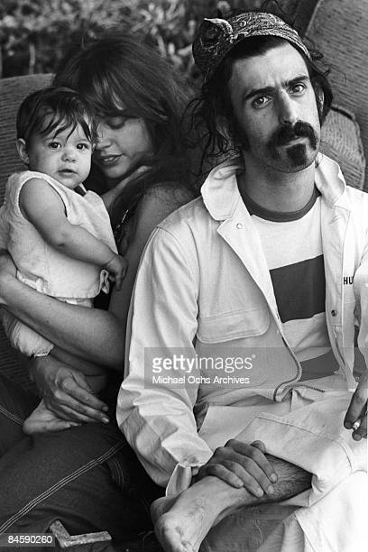 Rock and roll guitariist Frank Zappa poses for a portrait in Laurel Canyon with his wife Gail Zappa and daughter Moon Unit Zappa in February 1968 in...