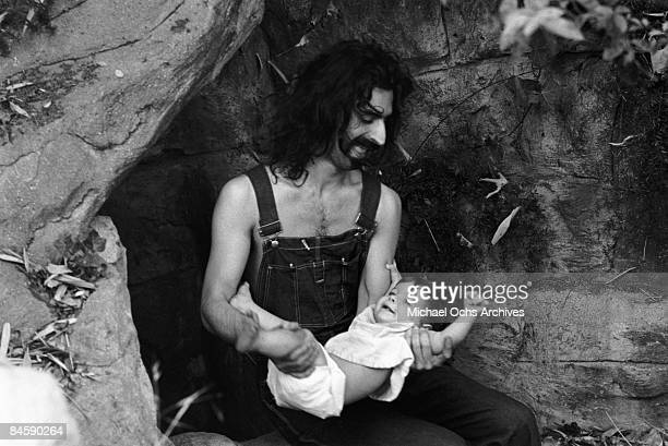 Rock and roll guitariist Frank Zappa poses for a portrait in Laurel Canyon daughter Moon Unit Zappa in February 1968 in Los Angeles California