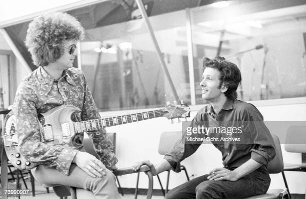 Rock and roll guitarist Eric Clapton of the rock band Cream and record producer Felix Pappalardi chat between takes at Atlantic Recording Studios in...
