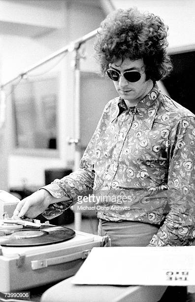 Rock and roll guitarist Eric Clapton of the rock band Cream puts an Albert King record entitled The Big on a record player while taking a break from...
