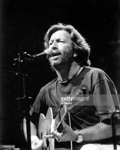 Rock and roll guitarist Eric Clapton plays an acoustic guitar as he performs onstage in circa 1992 in New York City, New York.