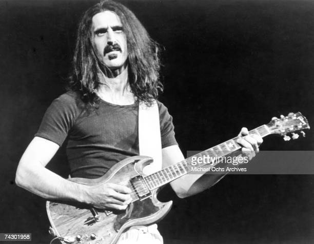 Rock and roll guitarist Frank Zappa plays a Gibson SG electric guitar as he performs onstage in circa 1977