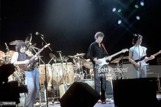 Rock and roll guitarists Eric Clapton Jeff Beck and Jimmy Page perform onstage at the ARMS Charity Concert at the Royal Albert Concert Hall in...