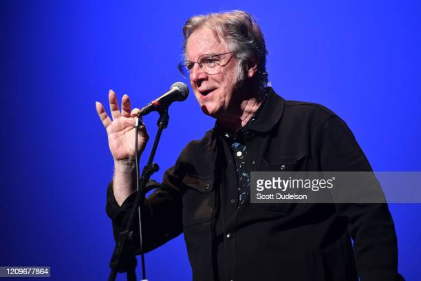 Rock and Roll Hall of Fame inductee John Sebastian founding member of The Lovin' Spoonful performs onstage during the Wild Honey Foundation's benefit...
