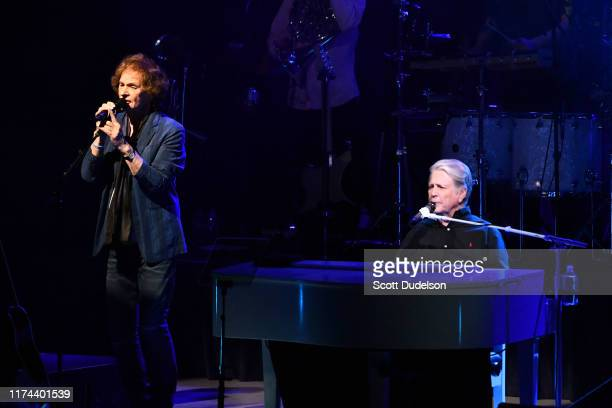 Rock and Roll Hall of Fame inductees Colin Blunstone of the Zombies and Brian Wilson of The Beach Boys perform onstage during the 'Something Great...
