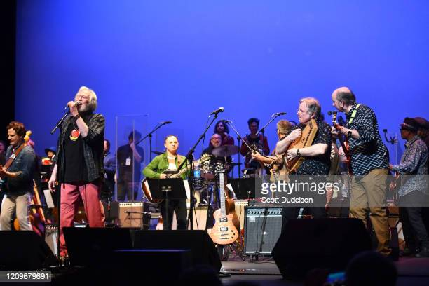 Rock and Roll Hall of Fame inductees Joe Butler, John Sebastian and Steve Boone, founding members of The Lovin' Spoonful, perform onstage for their...