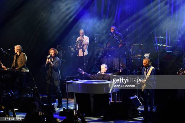 Rock and Roll Hall of Fame inductees Rod Argent and Colin Blunstone of The Zombies perform onstage as special guest of Brian Wilson and Al Jardine of...